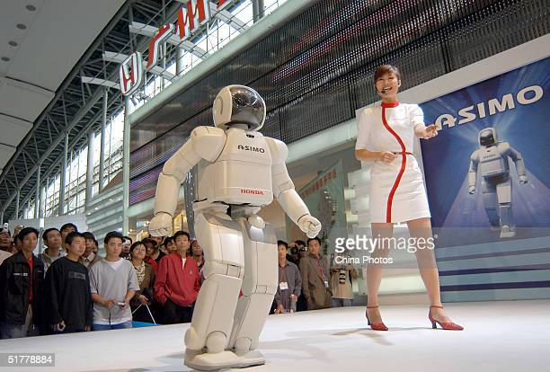 Japanese auto manufacturer HONDA shows its intellectualized robot ASIMO during the 2004 China Auto Exhibition on November 23 2004 in Guangzhou China...