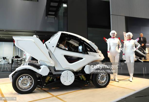 Japanese automobile venture Exmachina displays twoseater electric vehicle 'Earth1' which has fourwheel steering function at a press preview in Tokyo...