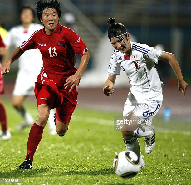 Japanese Ayu Nakada vies for the ball with North Korean Kim Nam Hui during the FIFA Women's Under17 semifinal match on September 21 at the Ato Boldon...