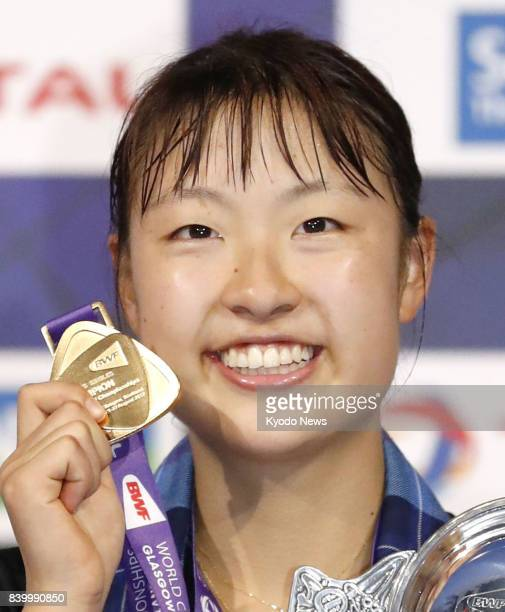 Japanese badminton player Nozomi Okuhara shows her singles gold medal at the world championships in Glasgow Scotland on Aug 27 2017 Okuhara became...