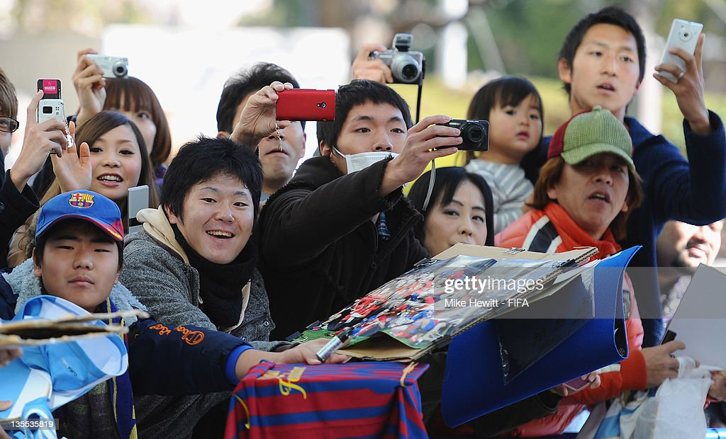 Japanese Barcelona fans wait for the players outside the team hotel prior to the Barcelona training at Marinos Town on December 12, 2011 in Yokohama, Japan.