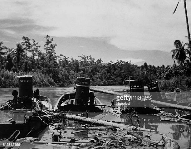 Japanese barges and tank lighters sunk in the Lunga River by American action | Location Lunga River Guadalcanal Island Solomon Islands