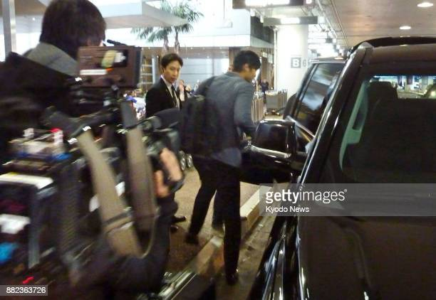 Japanese baseball star Shohei Otani of the Nippon Ham Fighters steps into his car after arriving at Los Angeles International Airport on Nov 29 2017...