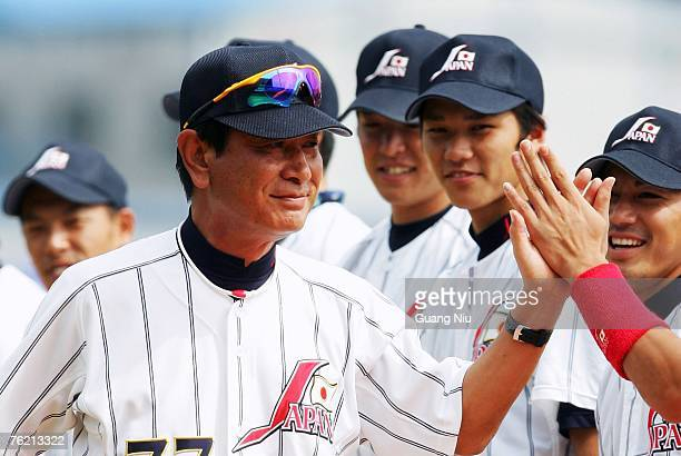 Japanese baseball team's manager Senichi Hoshino talks coaches his players ahead a match against France in the Good Luck Beijing baseball tournament...