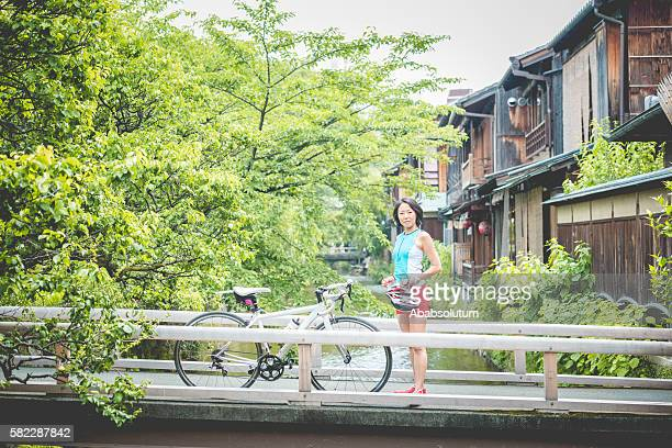 Japanese  Bicycle Rider Resting on Bridge in Gion, Kyoto, Japan