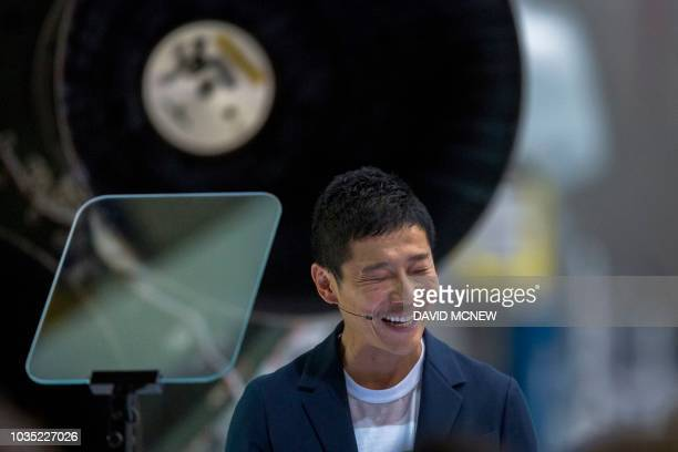 Japanese billionaire Yusaku Maezawa reacts near a Falcon 9 rocket during the announcement by Elon Musk to be the first private passenger who will fly...