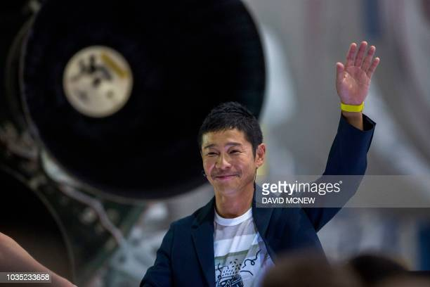 Japanese billionaire Yusaku Maezawa speaks near a Falcon 9 rocket during the announcement by Elon Musk to be the first private passenger who will fly...
