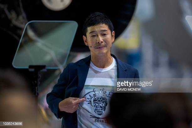 Japanese billionaire Yusaku Maezawa wears a shirt depicting the work of one of his favorite artists during the announcement by Elon Musk that he will...