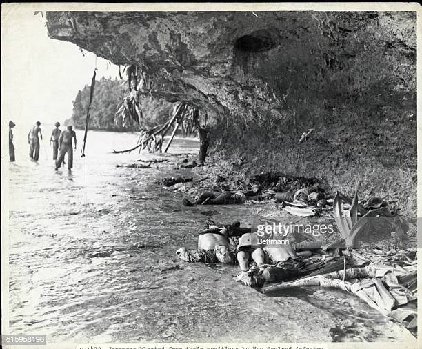 Japanese blasted from their positions by New Zealand infantry. World War II phptograph.