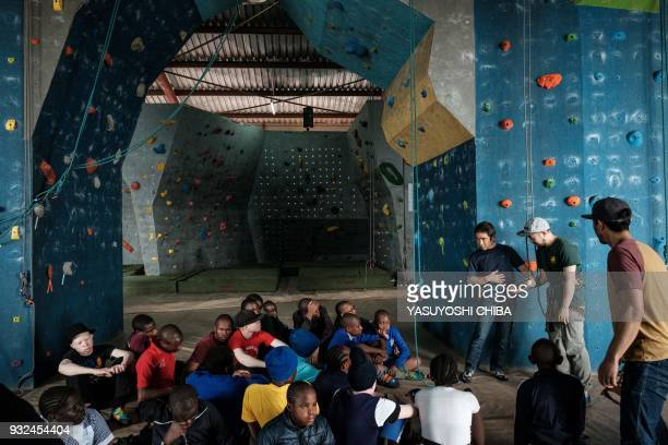 Japanese blind free climber Koichiro Kobayashi explains the rules during a weeklong free climbing training for visually impaired and blind students...