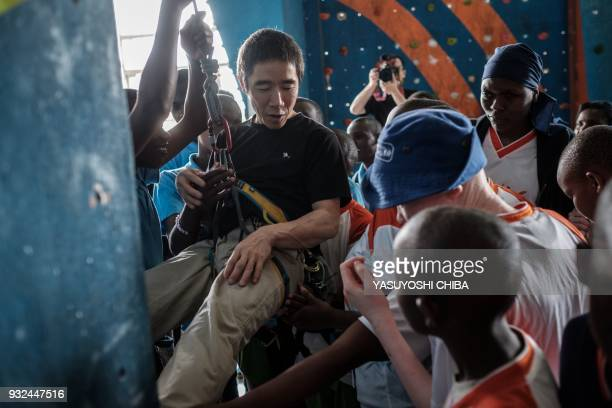 Japanese blind free climber Koichiro Kobayashi introduces climbing equipments to students of Thika school for the Blind during a weeklong free...