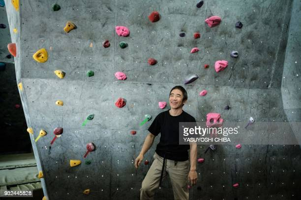 Japanese blind free climber Koichiro Kobayashi reacts during a weeklong free climbing training for visually impaired and blind students by the...