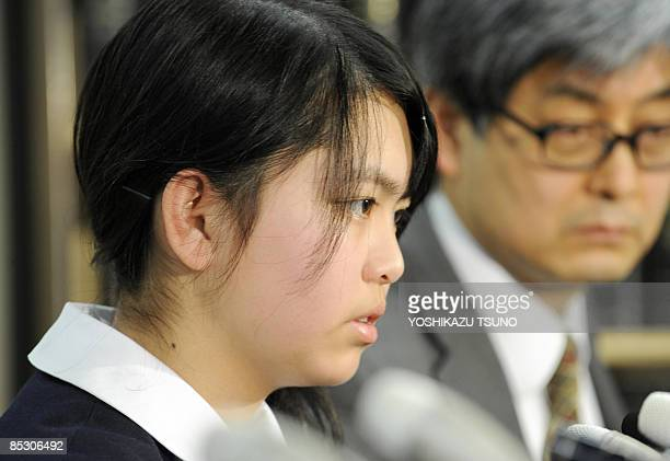 Japanese born 13yearold Noriko Calderon speaks at a press conference while her lawyer Shogo Watanabe looks on at a press conference in Tokyo on March...