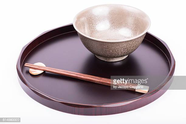 japanese bowl with chopsticks on a serving plate - jacopo caggiano stock pictures, royalty-free photos & images