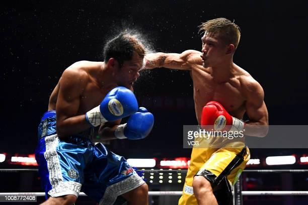 Japanese boxer Sho Kimura punches Filipino challenger Froilan Saludar during WBO Flyweight Title Bout at Qingdao Guosen Gymnasium on July 27, 2018 in...