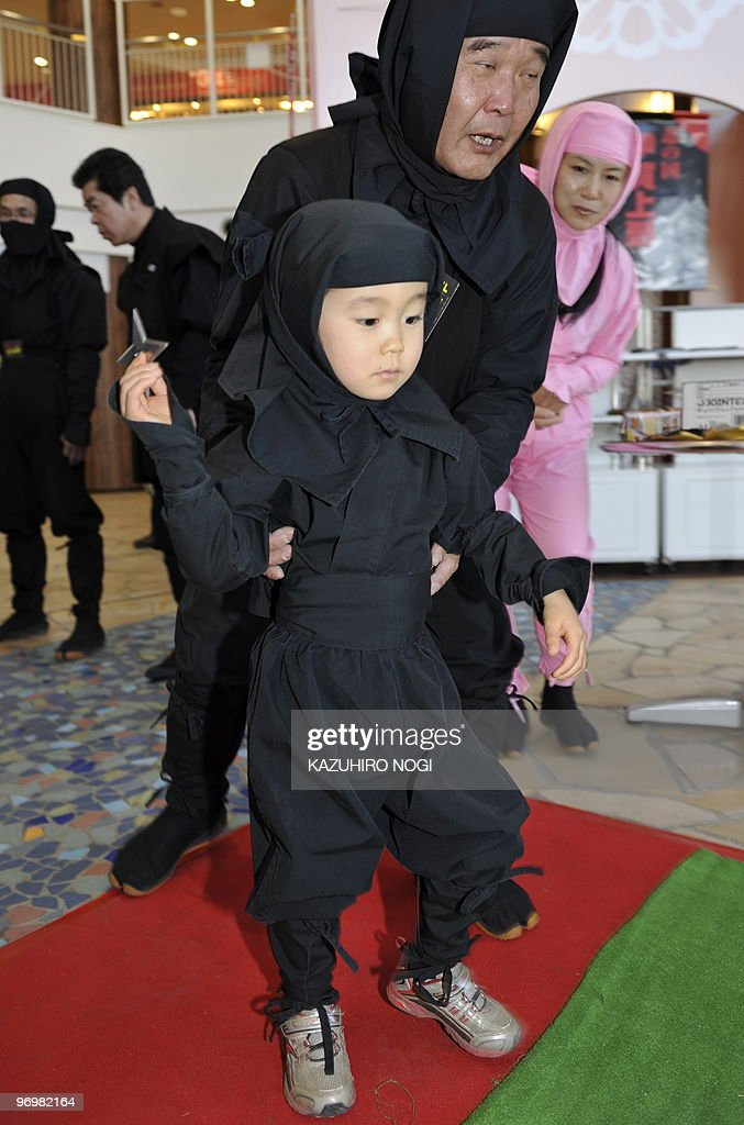 A Japanese boy dressed as a ninja throws a shuriken (literally 'sword hidden in the hand'), a traditional Japanese concealed weapon, during a ninja festival at a Tokyo amusement park on February 20, 2010. Some 70 people in ninja costume from Japan's Iga City, Mie Prefecture, made a shopping tour here to promote the city's annual ninja festival 'Iga Ueno Ninja Festa 2010.' A ninja was an assassin or spy in feudal Japan (circa 15th century), usually trained for stealth, espionage and other unorthodox arts of war. AFP PHOTO/Kazuhiro NOGI