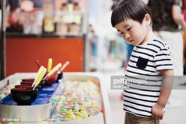 Japanese boy enjoying matsuri festivals