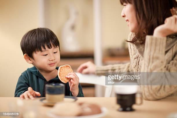 Japanese boy enjoys organic cookie