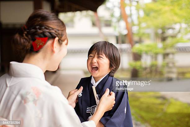 Japanese Boy Laughing with Mother at the Temple Celebrating Shichigosan