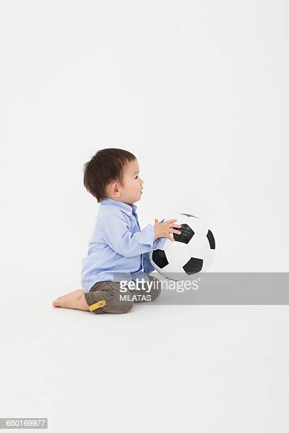 Japanese boy play with soccer ball