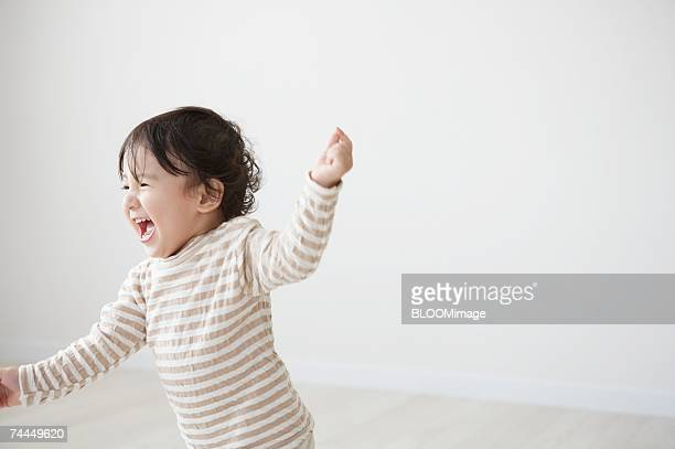 Japanese boy smiling in room