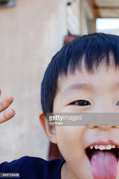 A Japanese boy sticking out his tongue