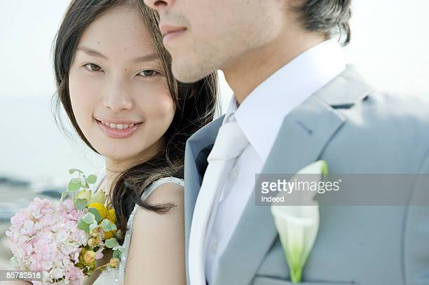 japanese bride smiling next to groom - kanagawa prefecture stock photos and pictures