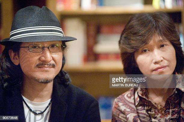 Japanese brother-sister duo Yuko and Shin Kibayashi known under the pen name Tadashi Agi sign autographs, on September 9, 2009 in Paris during a...