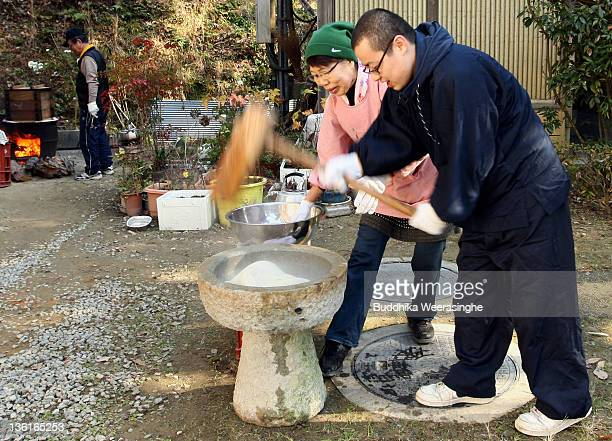 Japanese Buddhist Monk makes rice cakes Mochi for celebrations of the forthcoming Year of the Dragon at Zuiganji temple on December 28 2011 in Himeji...