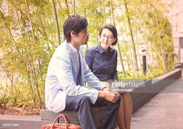 japanese business colleagues checking presentation in computer at kyoto japan - lypsekyo16 stock pictures, royalty-free photos & images