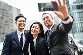 japanese business friends take a selfie all together