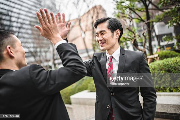 japanese business man having fun togetherness