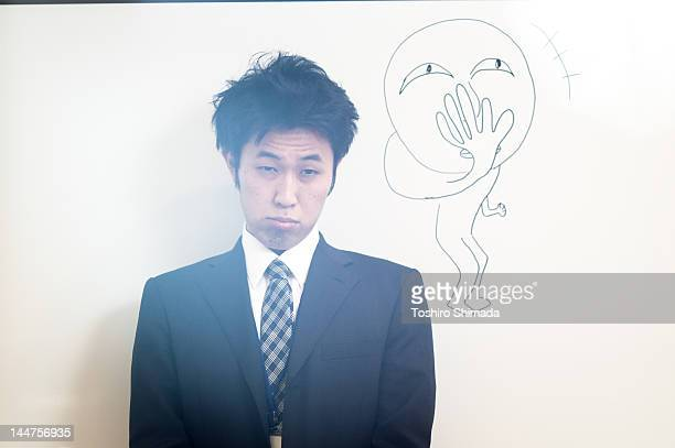 Japanese business man in front of white boar