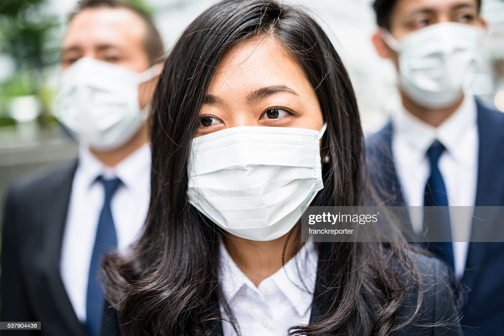 japanese Business man with pollution mask in Tokyo : Stock Photo