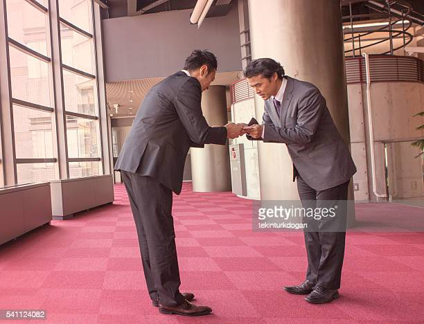 japanese business partners exchanging businesscard at kyoto japan - lypsekyo16 stock pictures, royalty-free photos & images