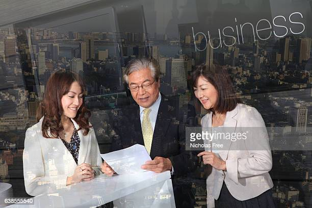 japanese business people against backdrop of tokyo - working seniors stock pictures, royalty-free photos & images