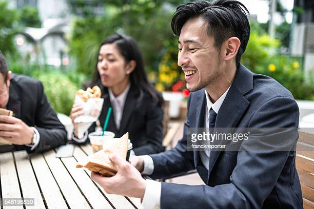 japanese business people doing the lunch break - lunch break stock pictures, royalty-free photos & images