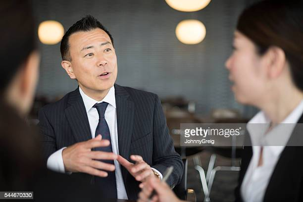 Japanese business people having discussion in meeting