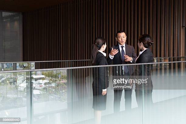 Japanese business people in meeting in modern office