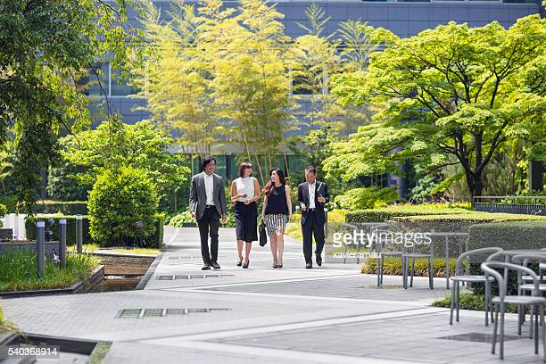 Japanese business people walking to the office