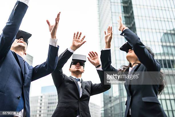 japanese business persons using the vr simulator on the city - adult video japan stock pictures, royalty-free photos & images