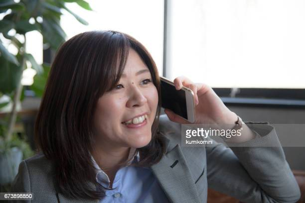Japanese business woman answering a call