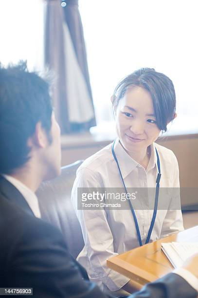 Japanese business woman laughing at office
