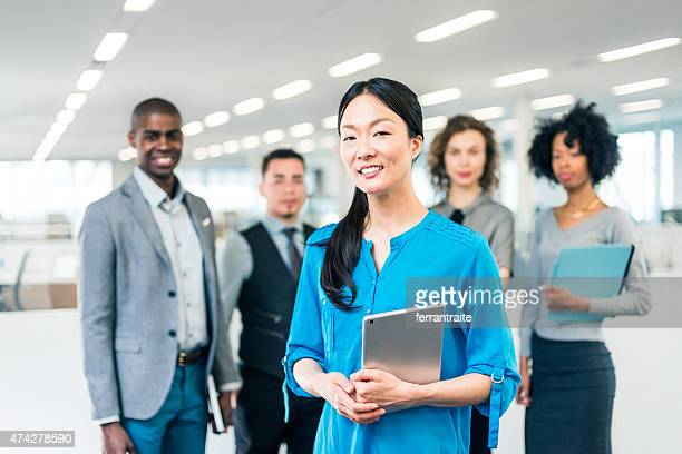 Japanese business woman manager of a multiracial business team