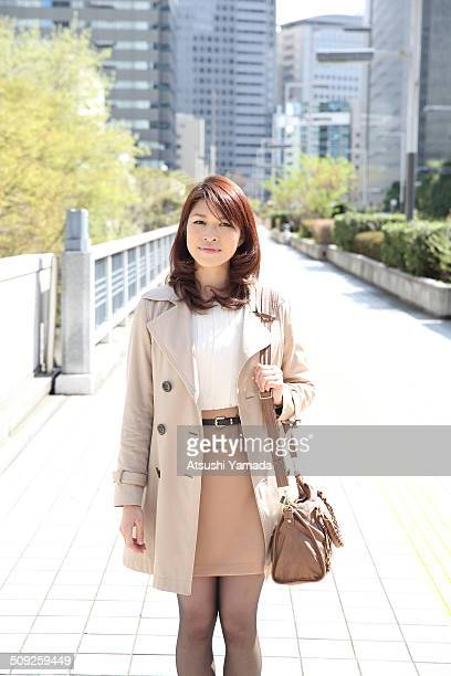Japanese business woman standing in city location