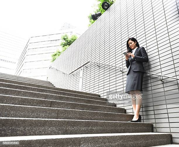 japanese Business woman standing on the step