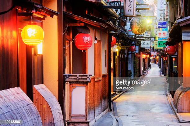 japanese businesses on a pedestrian street - kyoto prefecture stock pictures, royalty-free photos & images