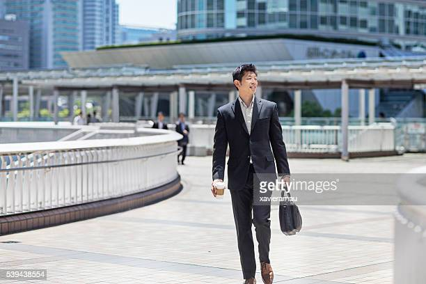 Japanese businessman commuting in the streets of Tokyo