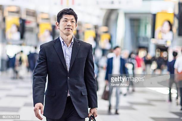 Japanese businessman commuting in Tokyo