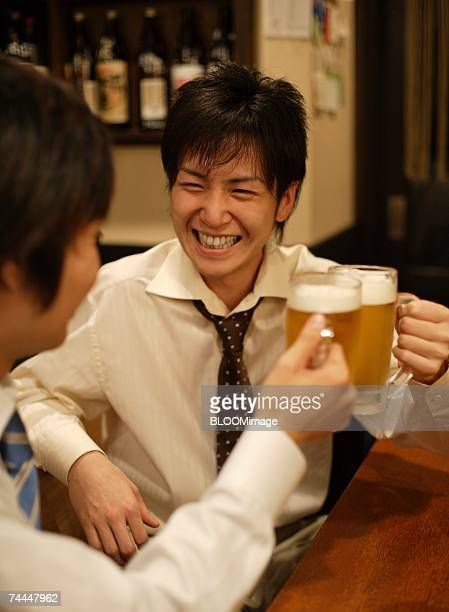 Japanese businessman drink a toast in Izakaya